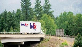 FedEx Freight truck traveling on the highway