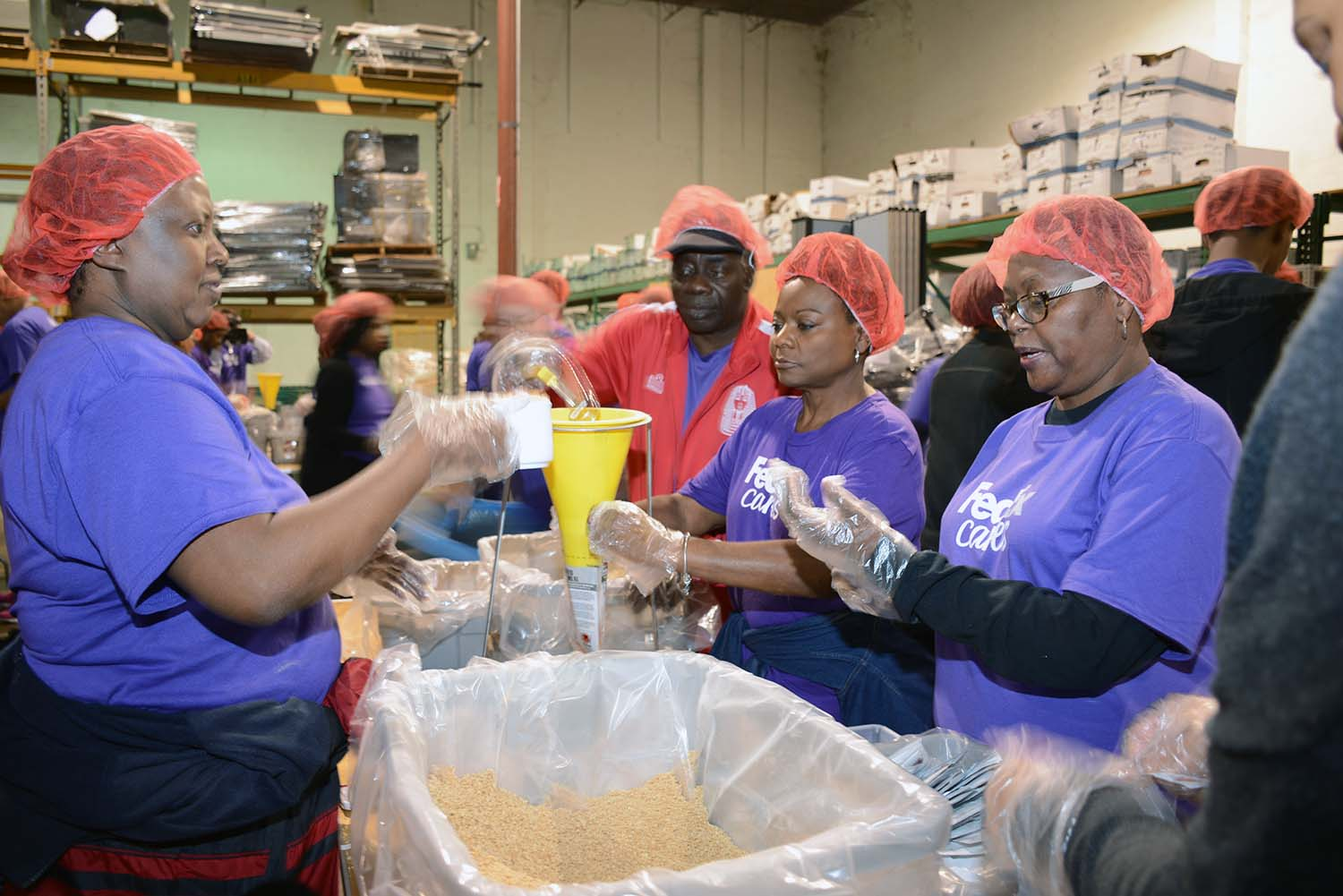 FedEx employees volunteering at Stop Hunger Now for MLK Day of Service