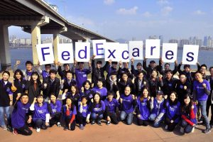 FedEx Cares volunteer pose after Children with Visual disabilities event